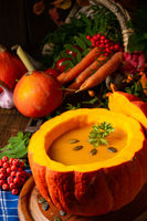 Delicious autumn pumpkin soup with baguette