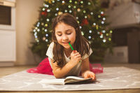 Writing letter to santa on Christmas eve at home