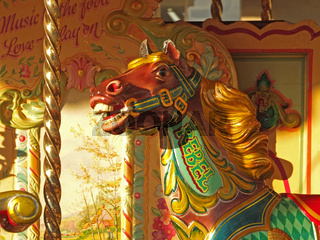 close up of a vintage carousel horses in the public square at Halifax piece hall west yorkshire