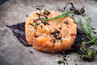Gourmet salmon fish tartar raw from salmon fillet with glasswort