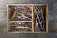 wooden box of used drills