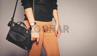 Girl is caring her handbag on her shoulder