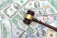 gavel is on the U.S. dollar different denominations