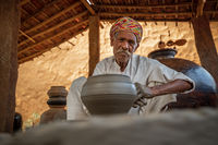Potter at work makes ceramic dishes. India, Rajasthan.