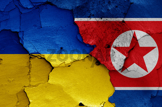 flags of Ukraine and North Korea painted on cracked wall