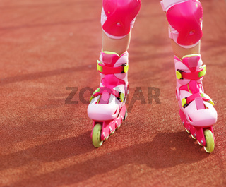 Rollerblades / inline skates of a child closeup in action outdoors