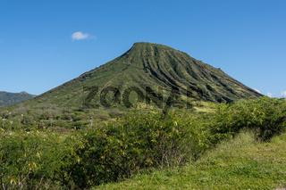 Hikers climbing the steep railway line trail to the top of Koko Head on Oahu