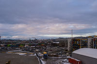 Looking over the port of Trondheim towards the city in early morning on overcast winter day