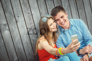 Young smiling couple doing selfie