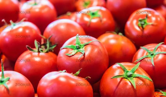 Fresh organic tomatoes on the street market stall.