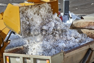 Loader removing snow from street