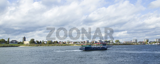 Skyline city Tiel with ferry boat