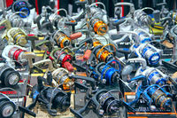 Fishing reels presented at exhibition in Kiyv. Wide assortment of goods for fishing. exhibition of g