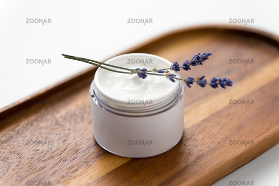 close up of lavender moisturizer on wooden tray