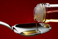 Pour the cooking oil into a tablespoon