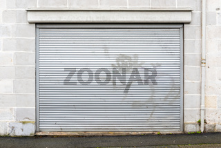 Metal roller security shutter