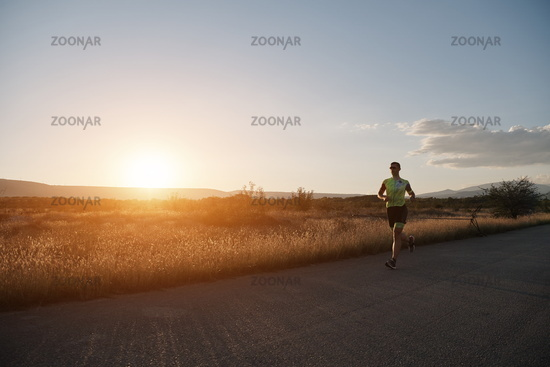 triathlon athlete running on morning trainig