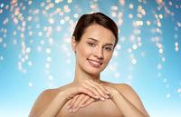beautiful young woman moisturizing her hands skin