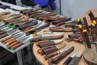 Sale of knives with bone handles. Knives for hunters at exhibition