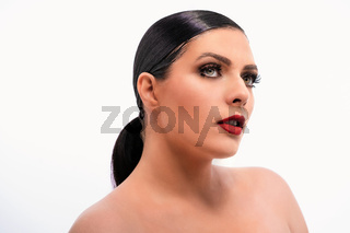 Brunette woman with bared shoulders and perfect skin looking aside. Isolated on white background. Beauty concept. Close up shot