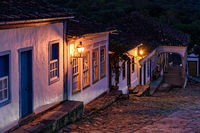 Night view of an old cobbled street and its colonial-style houses lit by lanterns in Tiradentes