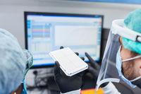 Forscher arbeiten an Experiment für Covid-19 Impfstoff