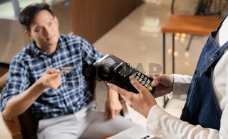 Cafe payment using EMV chip credit card.