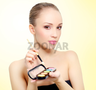 attractive girl with makeup palette
