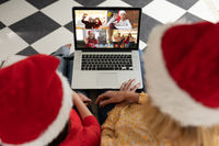 Caucasian woman and her child at christmas on a video call