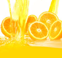 Fresh oranges falling in juice