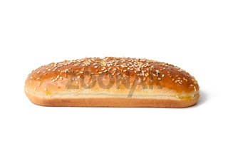 baked oval hot dog bun, baked goods sprinkled with sesame seeds