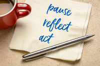 pause, reflect, act concept - words on napkin