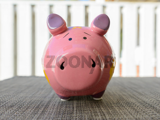 Piggy bank waiting for money investment and wealth outdoors
