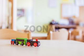 Children development concept: Close up of wooden toy railroad in the kindergarten