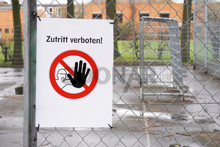Closed sports ground with prohibition sign Zutritt verboten - meaning no entry in German
