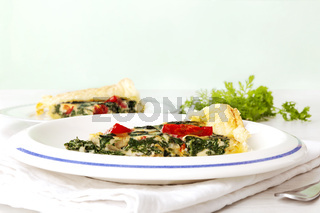 Home made spinach quiche on plate.