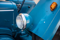 Headlights and indicators on the blue vintage tractor
