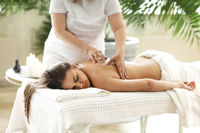 Young woman resting during spa procedure