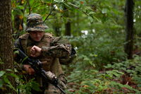soldier preparing tactical and commpunication gear for action battle