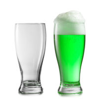 Empty and full glasses of green beer on a white background.