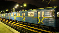 Electric train leaving station in subway in evening. Train leaving metro station. Underground train