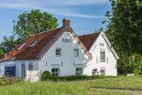 Historic houses at the harbor of Greetsiel, East Frisia, Lower Saxony, Germany