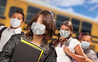 Hispanic Students Near School Bus Wearing Medical Face Face Masks