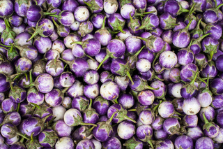 Eggplants at asian market. Organic food background