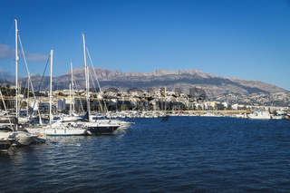 Boats at the port of Altea with view on mountain range with old city and cathedral, Altea, Costa Blanca, Spain