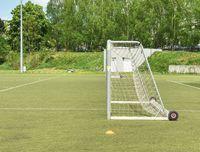 On football soccer field. Behind goal of soccer field. Soccer football net