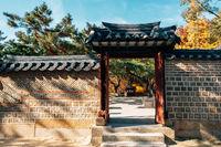 Autumn of Deoksugung Palace. Korean traditional door in Seoul, Korea