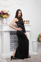 Cute young brunette wearing in a long evening dress