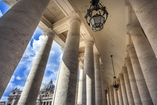 View through the colonnades at St. Peter's Square to St. Peter's Basilica in Rome Lazio Italy
