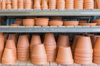 Garden shop with stone and ceramic flowerpots